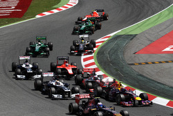 Mark Webber, Red Bull Racing RB9 and Jenson Button, McLaren MP4-28 at the start of the race