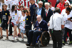 Frank Williams, Williams Team Owner pushed by Maria De Villota, at a FIA Safe Roads display with F1 personnel