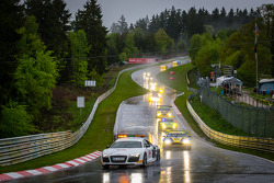 The safety car leads the field to the race restart