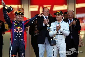 Sebastian Vettel, Red Bull Racing, celebrates his second position on the podium with race winner Nico Rosberg, Mercedes AMG F1