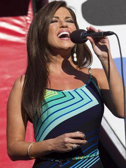 Robin Meade of CNN Headline News sings the National Anthem