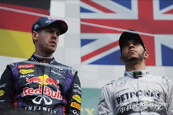 The podium: Sebastian Vettel, Red Bull Racing, race winner; Lewis Hamilton, Mercedes AMG F1, third