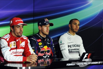 The FIA Press Conference, Fernando Alonso, Ferrari, second; Sebastian Vettel, Red Bull Racing, race winner; Lewis Hamilton, Mercedes AMG F1, third