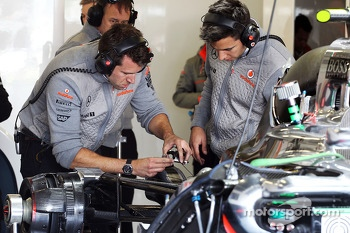 McLaren mechanics repair the McLaren MP4-28 of Sergio Perez, McLaren in the third practice session