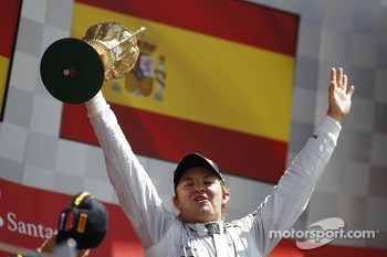 Race winner Nico Rosberg Mercedes AMG F1 celebrates on the podium