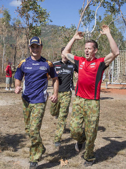 Tim Slade, Mark Winterbottom, Rick Kelly and James Courtney are put through there paces at an army obstacle course