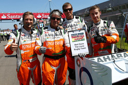 Sahara Force India F1 Team mechanics celebrate the Lions Rugby team's victory on the grid