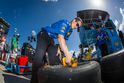 Crew member for Aric Almirola, Richard Petty Motorsports Ford prepares wheels and tires