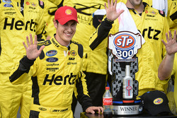 Race winner Joey Logano celebrates