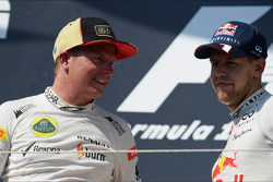 (L to R): second placed Kimi Raikkonen, Lotus F1 Team with third placed Sebastian Vettel, Red Bull Racing on the podium