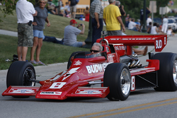 Race cars parade into Elkhart Lake for the Friday concours. #8 1978 Lightning Indy: David Roberts