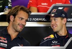 Jean-Eric Vergne, Scuderia Toro Rosso  and Sebastian Vettel, Red Bull Racing