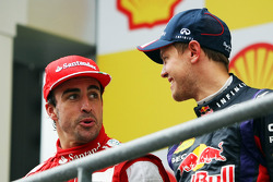 Fernando Alonso, Ferrari and race winner Sebastian Vettel, Red Bull Racing on the podium