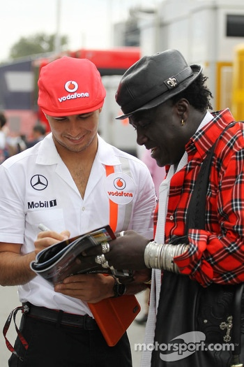 Sergio Perez, McLaren with Mr Moko