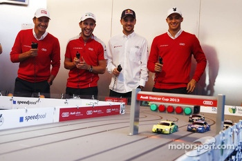 Timo Scheider, Mike Rockenfeller, Jamie Green and Edoardo Mortara at the Audi slotcar race