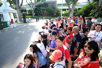 Fans waiting outside the paddock entrance