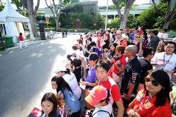 Fans waiting outside the paddock entrance