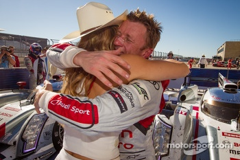 LMP1 and overall race winner Allan McNish celebrates with a charming hostess
