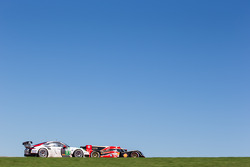 #12 Rebellion Racing Lola B12/60 Coupé - Toyota: Nicolas Prost, Nick Heidfeld, Mathias Beche, #91 Porsche AG Team Manthey Porsche 911 RSR: Jörg Bergmeister, Patrick Pilet