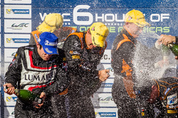 LMP2 podium: champagne for Pierre Kaffer, Roman Rusinov, John Martin and Mike Conway
