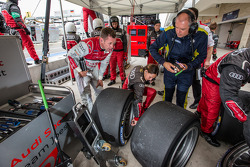 Tom Kristensen inspects tires