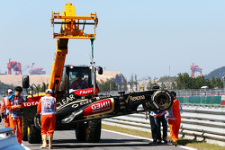The Lotus F1 E21 of Kimi Raikkonen, Lotus F1 Team is recovered back to the pits on the back of a truck after he crashed at the end of the first practice session