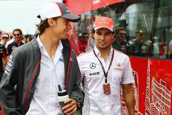 (L to R): Esteban Gutierrez, Sauber and Sergio Perez, McLaren on the drivers parade