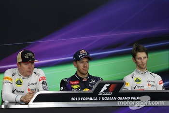 The post race FIA Press Conference: Kimi Raikkonen, Lotus F1 Team, second; Sebastian Vettel, Red Bull Racing, race winner; Romain Grosjean, Lotus F1 Team, third