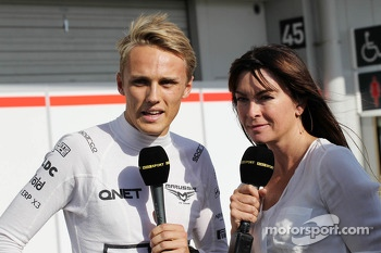 (L to R): Max Chilton, Marussia F1 Team with Suzi Perry, BBC F1 Presenter