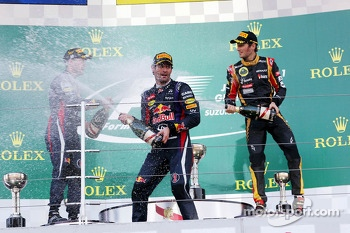 Mark Webber, Red Bull Racing celebrates his second position on the podium, with race winner Sebastian Vettel, Red Bull Racing, and third placed Romain Grosjean, Lotus F1 Team (Right)
