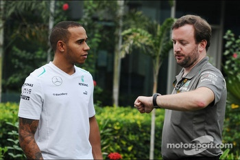 (L to R): Lewis Hamilton, Mercedes AMG F1 with Bradley Lord, Mercedes AMG F1 Communications Manager