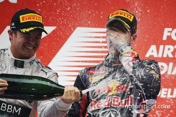 Race winner and World Champion Sebastian Vettel, Red Bull Racing celebrates on the podium with Nico Rosberg, Mercedes AMG F1