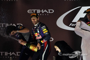 Mark Webber, Red Bull Racing celebrates his second position on the podium