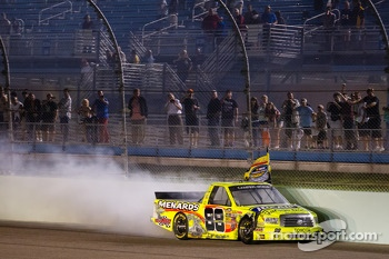 NASCAR Camping World Truck Series 2013 champion Matt Crafton celebrates