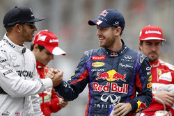 (L to R): Lewis Hamilton, Mercedes AMG F1 with Sebastian Vettel, Red Bull Racing on the drivers parade