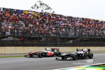 Sergio Perez, McLaren MP4-28 and Valtteri Bottas, Williams FW35 battle for position