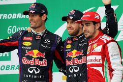 The podium, Red Bull Racing, second; Sebastian Vettel, Red Bull Racing, race winner; Fernando Alonso, Ferrari, third