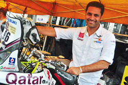 Nasser Al-Attiyah with his bike team