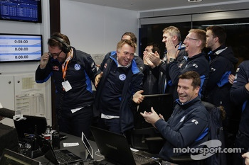 The Volkswagen Motorsport team celebrates