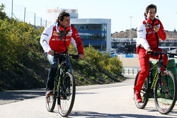 (L to R): Pedro De La Rosa, Ferrari Development Driver cycles the perimiter road with Massimo Rivola, Ferrari Sporting Director