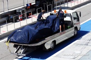 The Mercedes AMG F1 W05 of Jean-Eric Vergne, Scuderia Toro Rosso is recovered back to the pits on the back of a truck