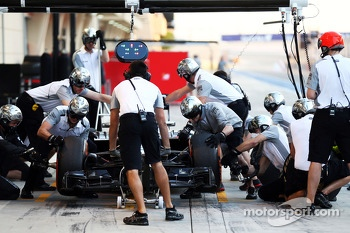 Jenson Button, McLaren MP4-29 practices a pit stop