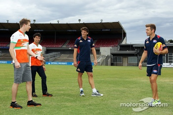 (L to R): Nico Hulkenberg, Sahara Force India F1 and team mate Sergio Perez, Sahara Force India F1 have an Aussie Rules skills lesson from Will Minson, Western Bulldogs Australian Rules Footballer and Shaun Higgins, Western Bulldogs Australian Rules Footb