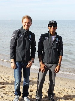 Nico Rosberg, Mercedes AMG F1 and team mate Lewis Hamilton, Mercedes AMG F1 on the beach