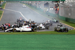 Kamui Kobayashi, Caterham CT05 crashes into Felipe Massa, Williams FW36 at the start of the race