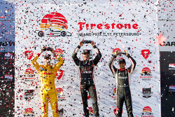 Race winner Will Power, second place Ryan Hunter-Reay, third place Helio Castroneves