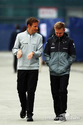 (L to R): Jenson Button, McLaren with team mate Kevin Magnussen, McLaren
