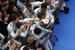 Race winner celebrates in parc ferme with the team