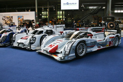 A Toyota TS040 Hybrid, Porsche 919 Hybrid and Audi R18 e-tron quattro on display at the Autoworld museum in Brussels