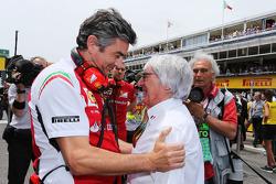 (L to R): Marco Mattiacci, Ferrari Team Principal with Bernie Ecclestone, on the grid